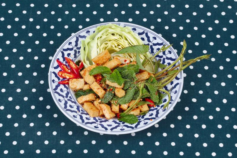 Spicy sour mixed herb salad with fried tofu. Spicy sour mixed herb salad with fried tofu for Chinese vegetable festival royalty free stock photo