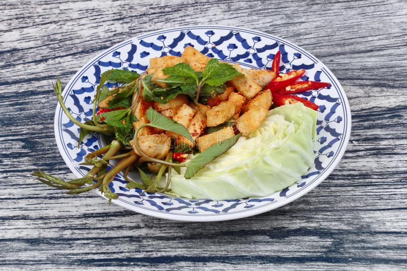 Spicy sour mixed herb salad with fried tofu. Spicy sour mixed herb salad with fried tofu for Chinese vegetable festival stock photos