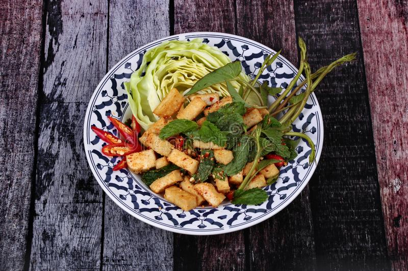Spicy sour mixed herb salad with fried tofu. Spicy sour mixed herb salad with fried tofu for Chinese vegetable festival stock photography