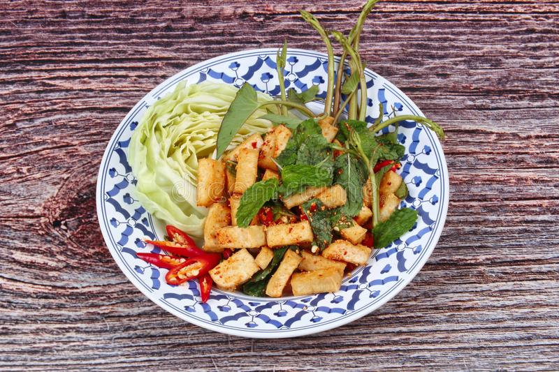 Spicy sour mixed herb salad with fried tofu. Spicy sour mixed herb salad with fried tofu for Chinese vegetable festival stock images