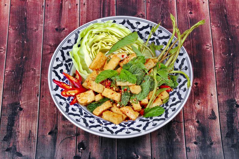 Spicy sour mixed herb salad with fried tofu. Spicy sour mixed herb salad with fried tofu for Chinese vegetable festival royalty free stock images