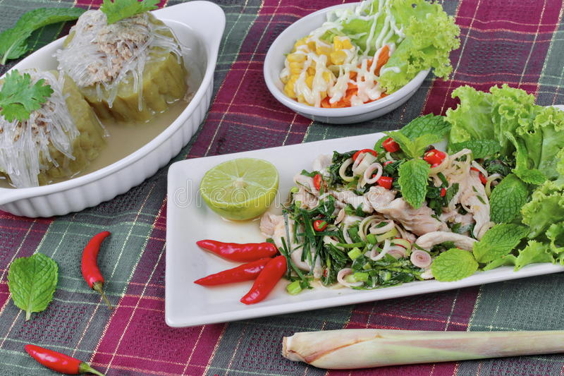 Spicy and sour mixed herb salad with meat and side dish. Selective focus. Selective focus. Spicy and sour mixed herb salad with pork and chicken is Thai cuisine stock image