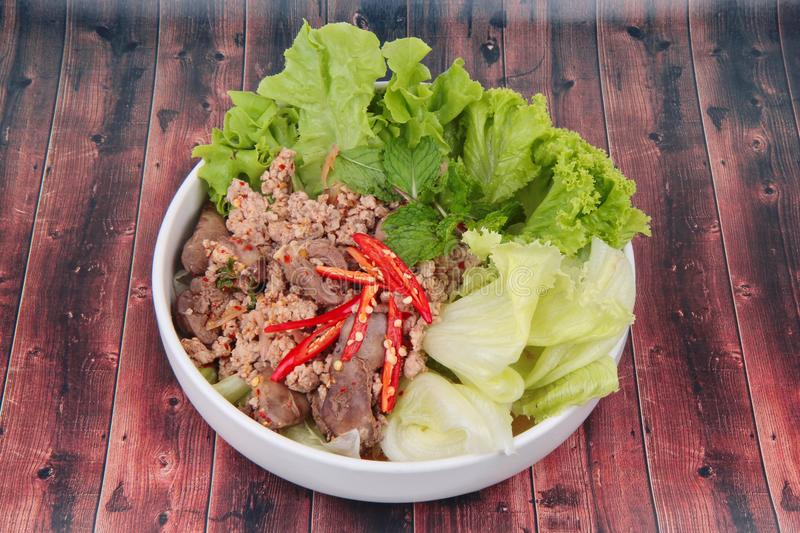 Spicy and sour mixed herb salad with minced pork and chicken. Popular Thai food ,Sliced grilled beef salad ,Spicy and sour mixed herb salad with minced pork and stock photography