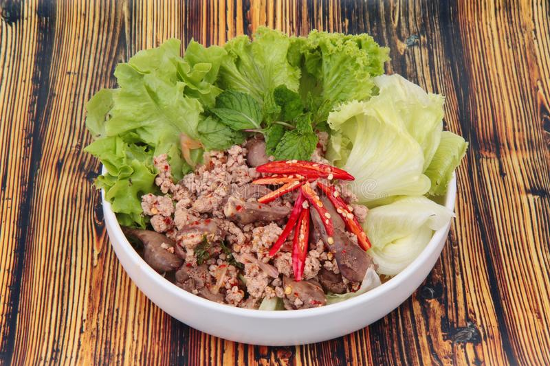 Spicy and sour mixed herb salad with minced pork and chicken. Popular Thai food ,Sliced grilled beef salad ,Spicy and sour mixed herb salad with minced pork and royalty free stock images