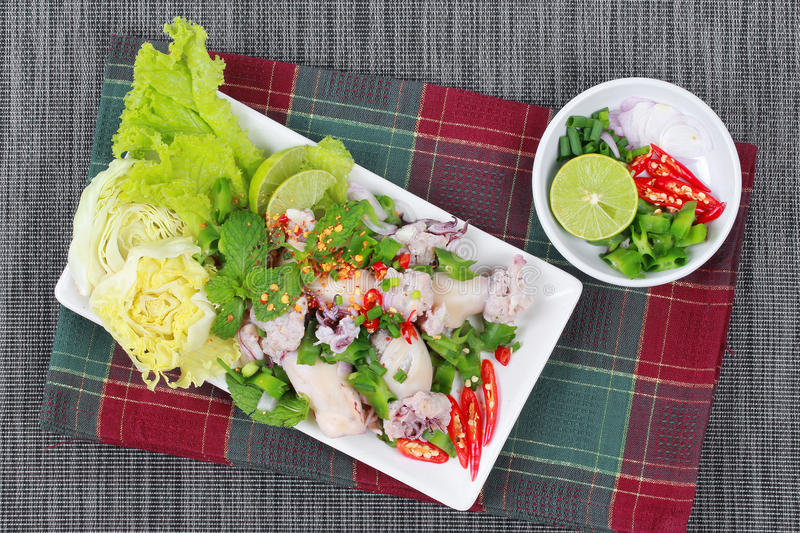 Spicy and sour mixed herb salad with squid wrap minced pork. Side view. Spicy and sour mixed herb salad with squid wrap minced pork salad is Thai cuisine as royalty free stock photo