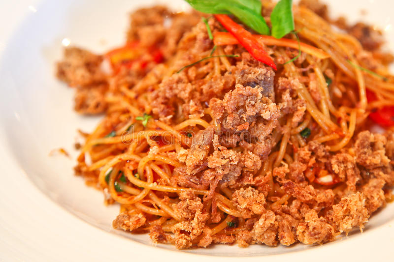 Spicy spaghetti with crispy pork royalty free stock image