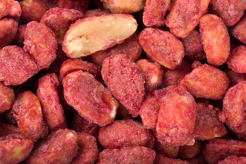 Spicy spice coated peanuts. Closeup of red spicy spice coated peanuts texture royalty free stock photography