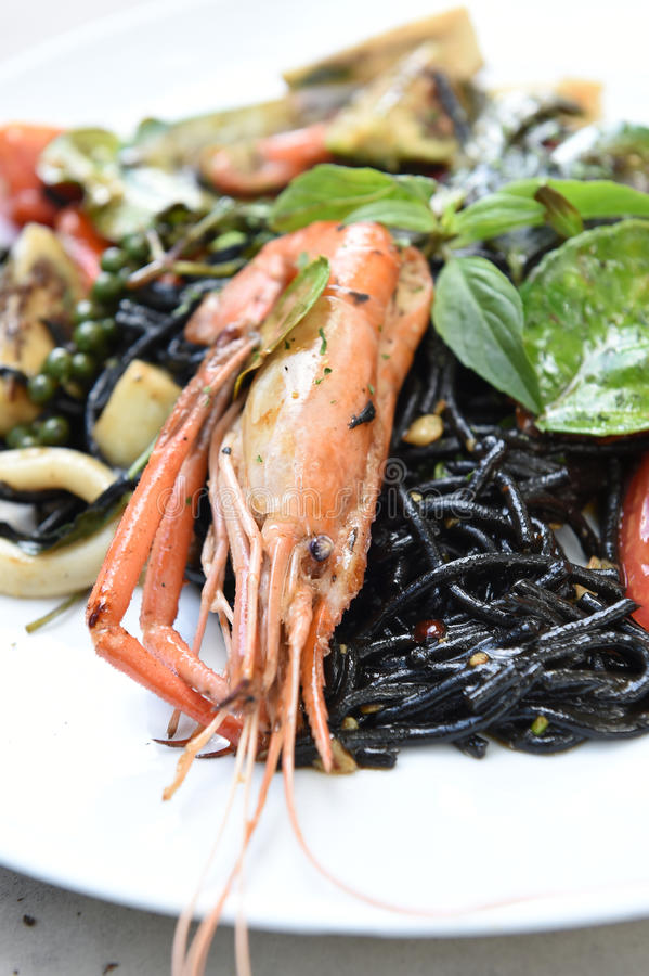 Spicy squid ink spaghetti with green mussel and shrimp.  stock photography