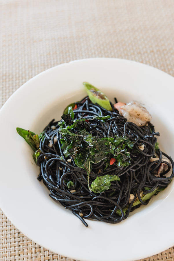 Spicy squid ink spaghetti with green mussel and shrimp. Top view stock photos