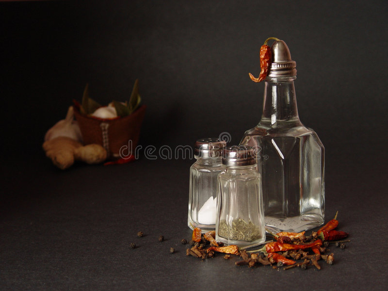 Spicy still-life. Salt, pepper and vinegar stock images