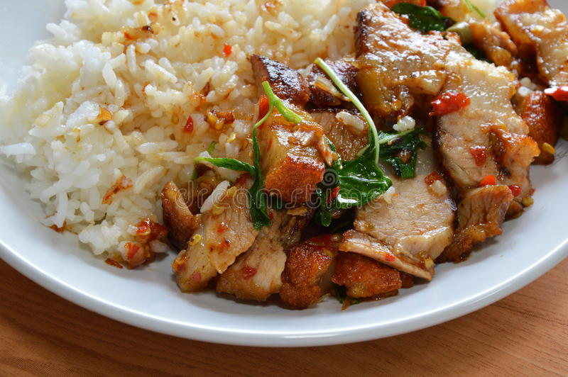 Spicy stir fried crispy pork with basil leaf royalty free stock photos