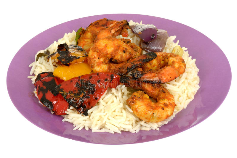 Spicy Tandoori King Prawns with Rice and Peppers royalty free stock photography