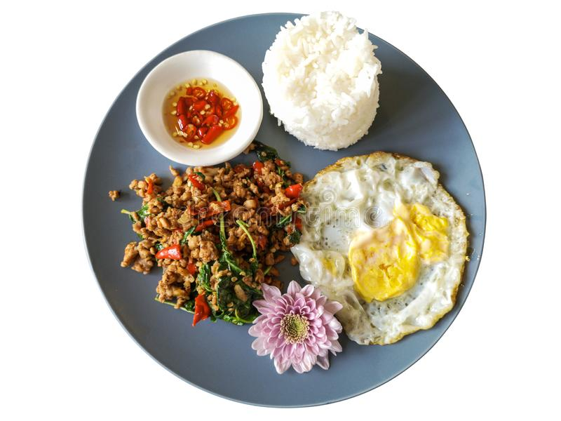 Spicy Thai food rice topped stir-fried pork and basil with Fried egg in gray dish isolate on white background. Spicy Thai food rice topped stir-fried pork and stock photo