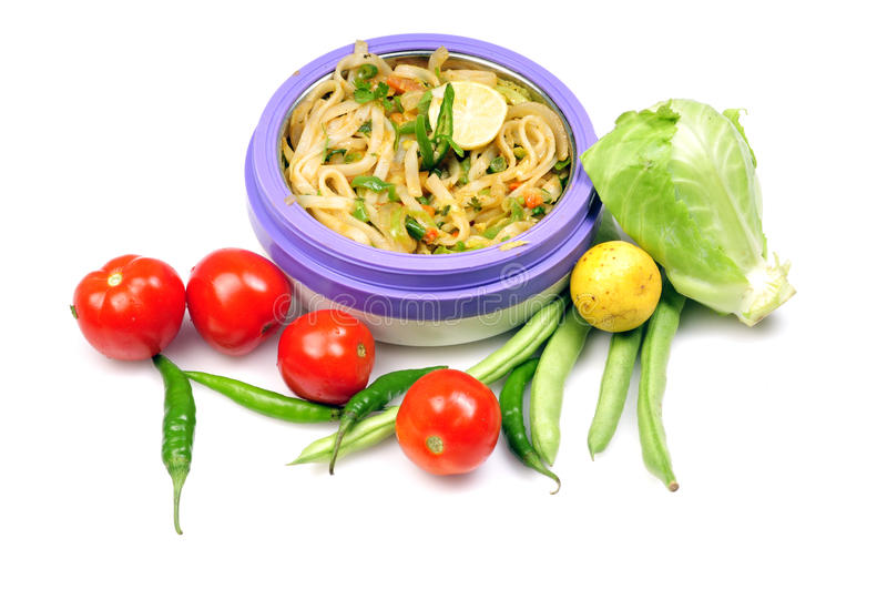 Spicy thai noodles. With fresh vegetables isolated on white background stock image