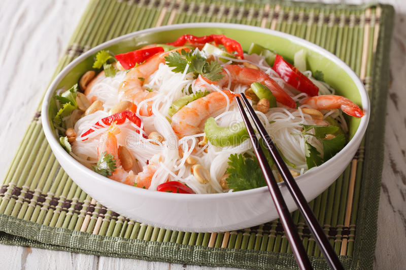 Spicy Thai salad yam woon sen with seafood close up. horizontal. Spicy Thai salad yam woon sen with seafood close up on a plate. horizontal stock photography