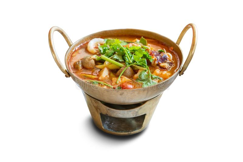 Spicy Thai traditional food ` Tom Yum Goong Sea Food ` in the brass hot pot. royalty free stock photo