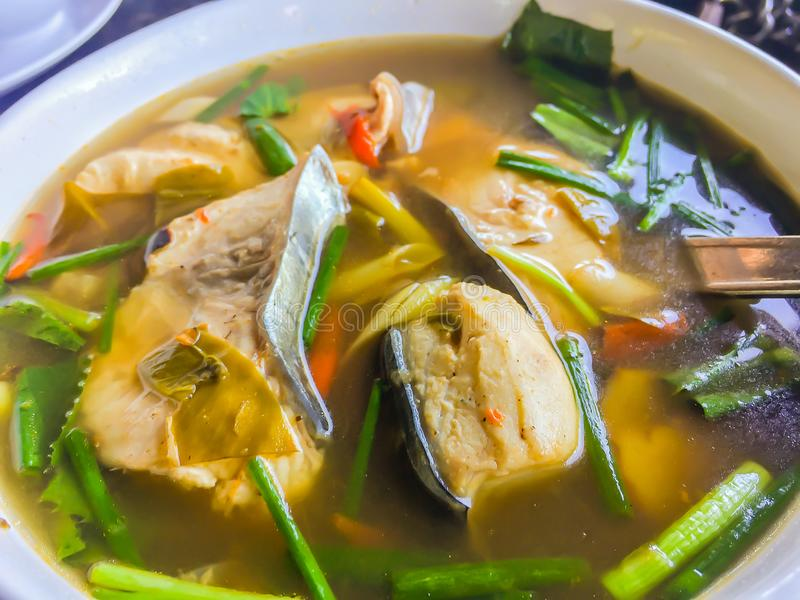 Spicy tom yum fish with thai herb ingredients. Hot spicy and sour Tom Yum fish and seafood soup with herbs, Thai local food royalty free stock image