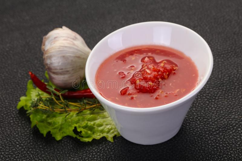 Spicy tomato and garlic sauce stock images