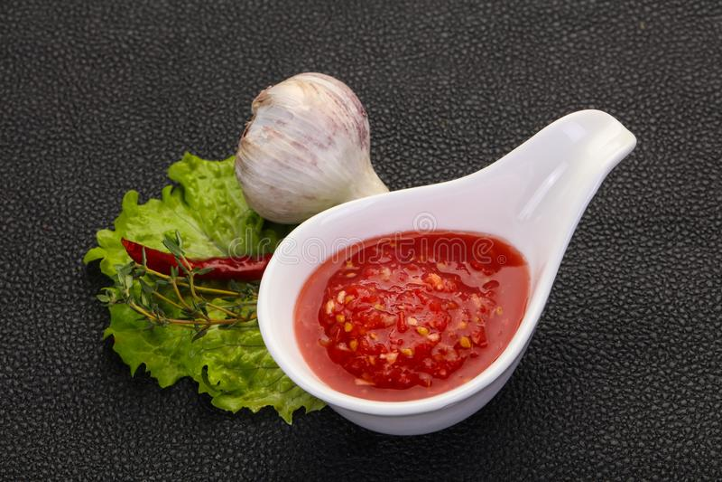 Spicy tomato and garlic sauce. Spicy tomato, horse radish and garlic sauce stock photos