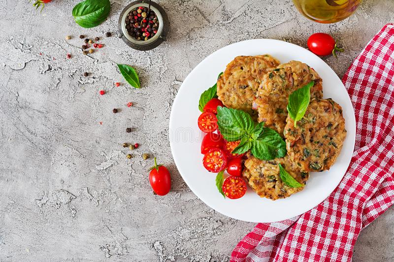 Spicy vegan burgers with rice, chickpeas and herbs. Salad tomato and basil. royalty free stock photography