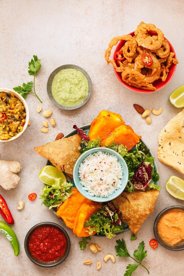 Spicy vegetable and meat Indian snacks royalty free stock image