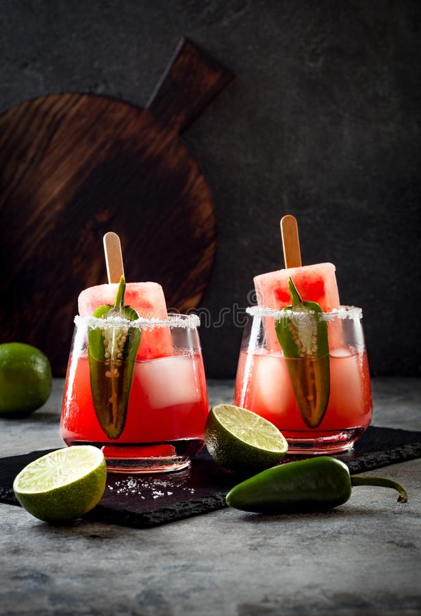 Spicy watermelon popsicle margarita cocktail with jalapeno and lime. Mexican alcoholic drink for Cinco de mayo party. Spicy watermelon popsicle margarita royalty free stock photos
