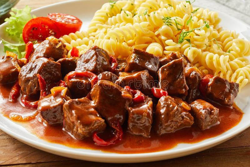 Spicy wild game goulash with deer venison royalty free stock photo