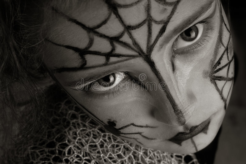 Spider girl. Girl with spider make-up in sepia tones