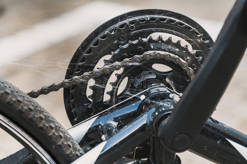 Spider web on bicycle gear. It has not been used for a long time. A dense web is located on the gear and chain transmission of a modern bicycle royalty free stock photos
