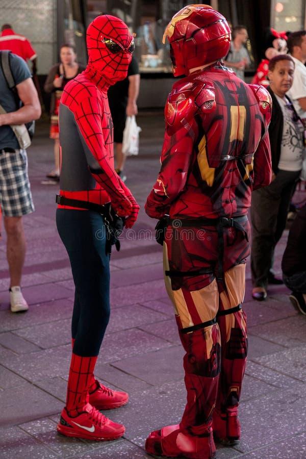 Spiderman- och Ironman utbytespengar arkivfoton