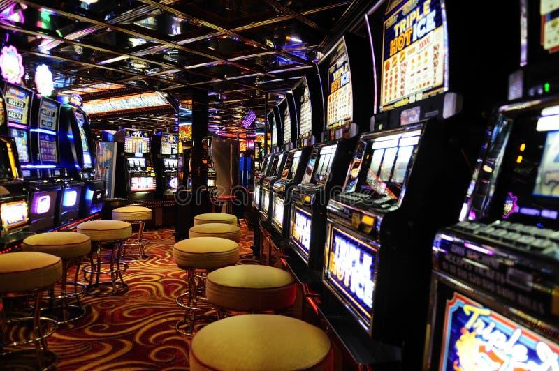 Spielautomaten - Kasino - Bargeld-Spiele - Einkommen lizenzfreie stockbilder