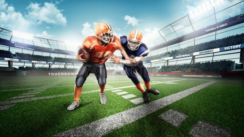 Spieler des amerikanischen Fußballs auf grünem Gras stockfotos