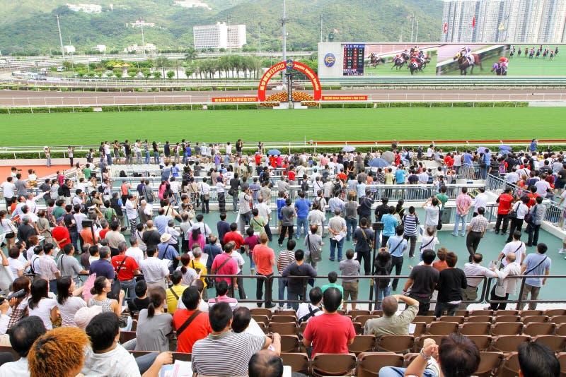 Spieler Sha Tin Racecourse, die im Zahlwerk spielen lizenzfreie stockfotografie