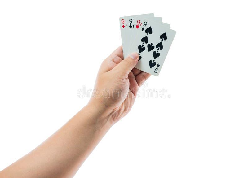 Spielkarten in der Hand lokalisiert auf weißem Hintergrund stockfoto