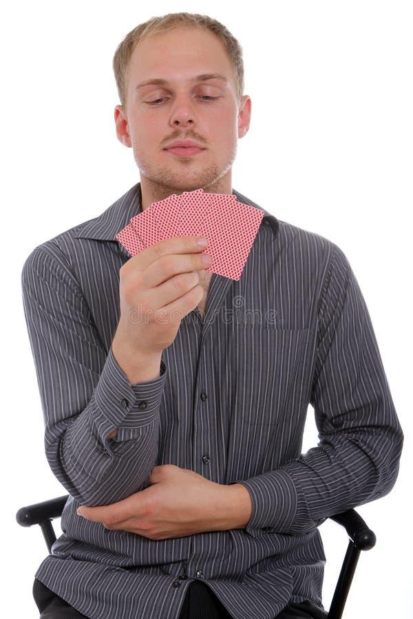 Spielkarten des Mannes lizenzfreie stockbilder