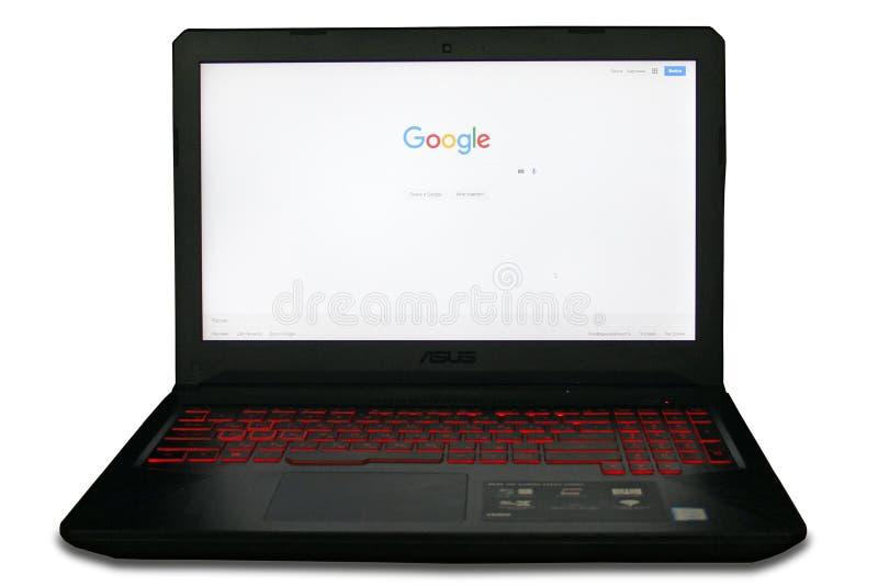 SpielLaptop-Computer mit Google-Suchmaschineanfangsseite stockfotografie