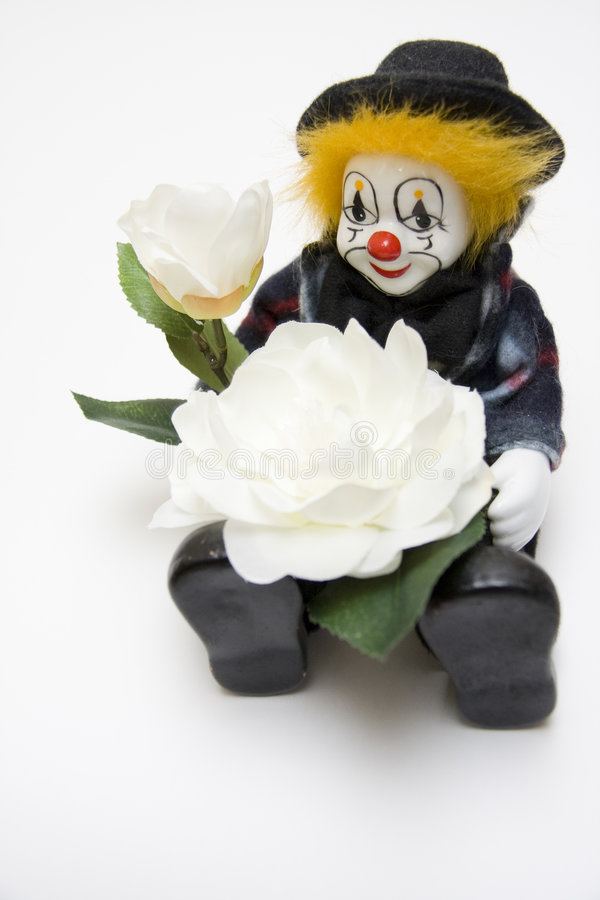 Spielzeug-Clown mit Rosen stockfotos