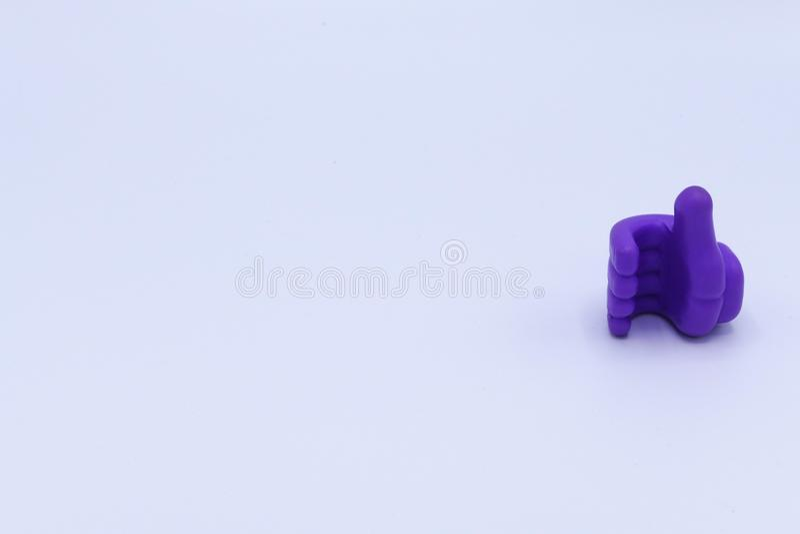 Spielzeug ist purpurroter Handdaumen ungefähr wie stockbilder