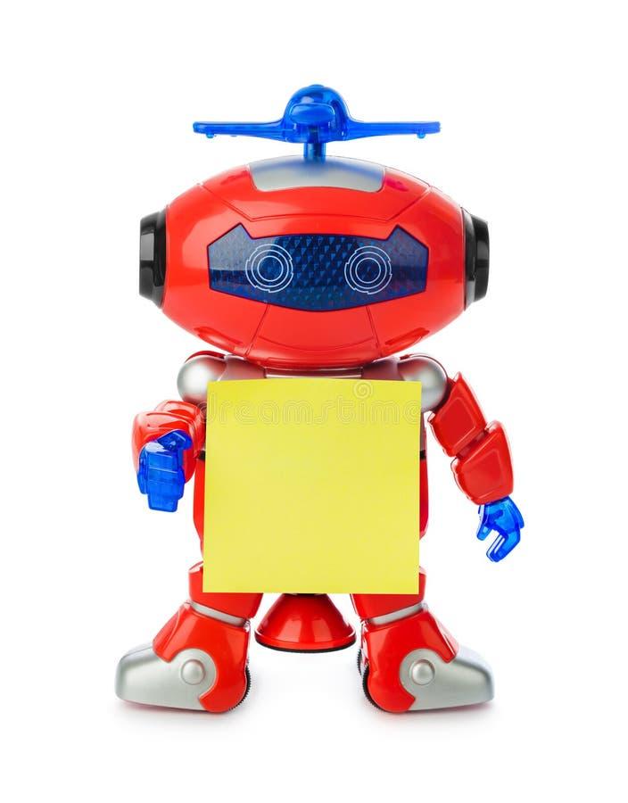 Spielzeugroboter mit leerem Papier lizenzfreies stockfoto