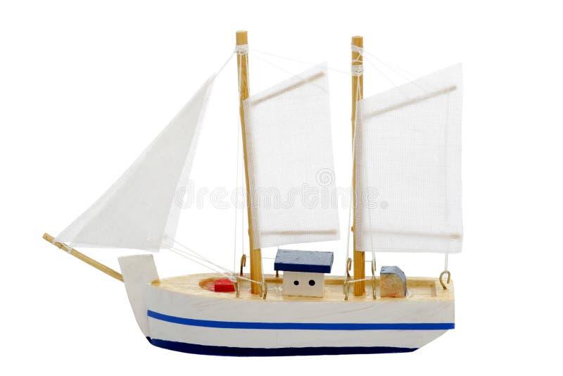 Spielzeugsegelnboot lizenzfreie stockfotos