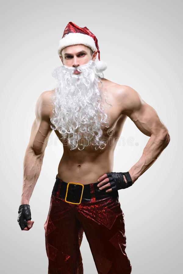 Spier knappe sexy Santa Claus royalty-vrije stock fotografie