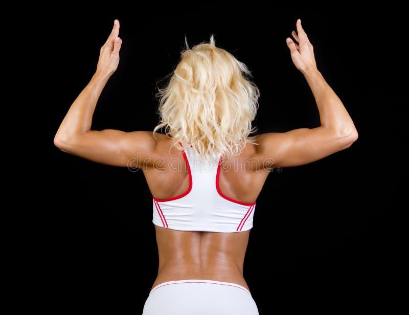 Spier rug van sportvrouw stock afbeeldingen