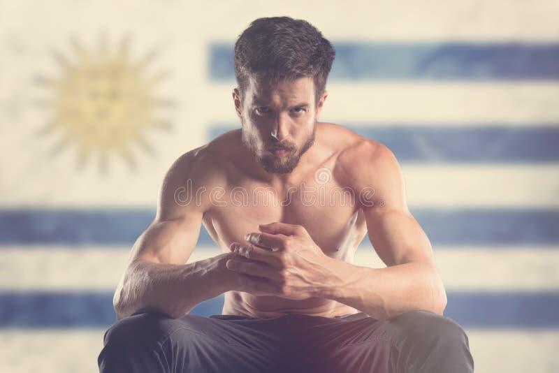 Spiermens met erachter de Vlag van Uruguay stock foto's