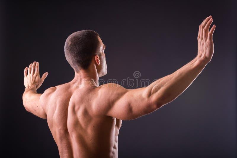 Spiermensenbodybuilder stock afbeelding