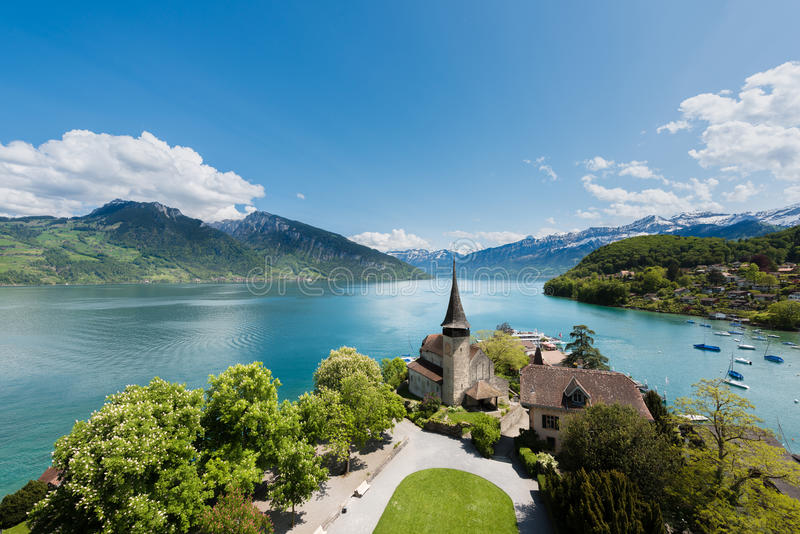 Spiez castle with sailboat on lake Thun in Bern, Switzerland. royalty free stock images
