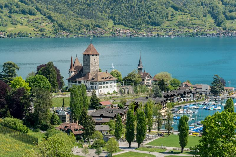 Spiez castle with sailboat on lake Thun in Bern, Switzerland. stock photos