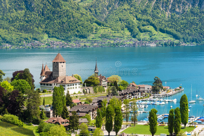Spiez castle with yacht ship on lake Thun in Bern, Switzerland. Beautiful landscape in Switzerland. stock photos