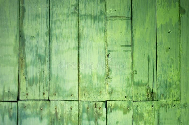 Spikar målade och befläckte träplankor för gammal gräsplan med huvud arkivbild