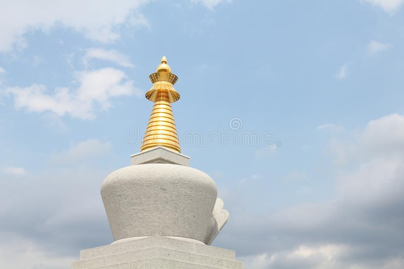The spike of enlightenment stupa in village of Plana. Plana is Bulgarian village in City of Sofia Province. A stupa is a mound-like or hemispherical royalty free stock photo