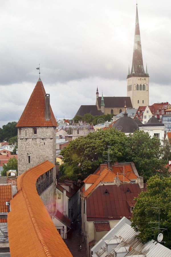 Spike of St Olaf Oleviste Church and fortification tower. Tallinn, Estonia royalty free stock photo